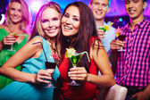Girls with cocktails — Stock Photo
