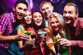 Friends having fun with cocktails — Stock Photo