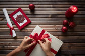 Preparing Christmas gift — Stock Photo