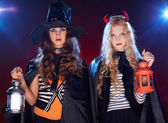 Halloween females with lanterns — Stock Photo