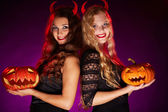 Girls with carved Halloween pumpkins — Stock Photo