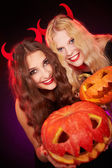 Girls showing carved Halloween pumpkins — Stock Photo