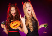 Girls with Halloween pumpkin and cocktails — Stock Photo