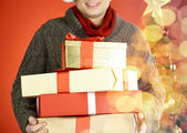 Man with giftboxes — Stock Photo