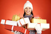 Happy girl with giftboxes — Stock Photo