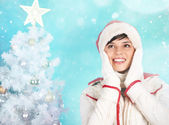 Joyful girl in Santa cap — Stock Photo