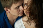 Woman with her sweetheart near by — Stock Photo