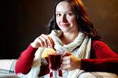 Pretty female holding glass of hot tea — Stock Photo