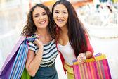 Consumers with handbags — Stock Photo