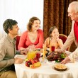 Gathered at dinner table — Stock Photo