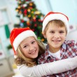 Affectionate kids on Christmas evening — Stock Photo