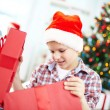 Boy looking inside big red giftbox — Stock Photo