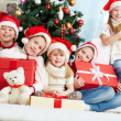 Friends by Christmas tree — Stock Photo