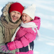 Man and his daughter in winter — Stock Photo