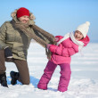 Man and his daughter having fun in winter — Stock Photo