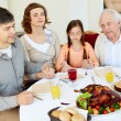 Family at Thanksgiving table — Stock Photo #36817405