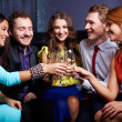 Friends toasting with flutes of champagne — Stock Photo #36817453