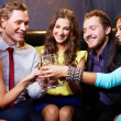 Friends toasting with flutes of champagne — Stock Photo
