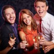 Group of joyful friends toasting — Stock Photo