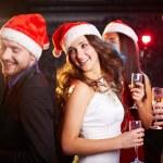 Friends in Santa caps dancing — Stock Photo #36817491