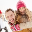 Happy young in winter park — Stock Photo