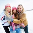 Stock Photo: Friends standing in snowdrift in winter