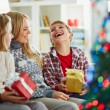 Woman and her two children sitting at home on Christmas — Stok fotoğraf