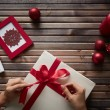 Stock Photo: Preparing Christmas gift
