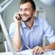 Businessman speaking on the phone — Stock Photo