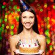 Girl holding birthday cake — Stock Photo