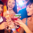 Stock Photo: Friends toasting at birthday party