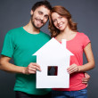 Stock Photo: Couple with paper house