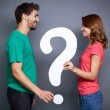 Couple holding paper question mark — Stock Photo