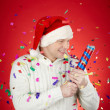 Joyful min Santcap with confetti cracker — Stock Photo #36819197