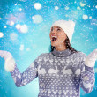 Girl in winterwear enjoying snowfall — Stock Photo #36819259