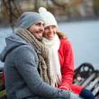 Couple sitting on the bench in park — Foto Stock