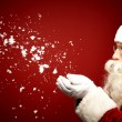 Santa Claus blowing snow — Stock Photo