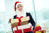 Businessman in Santa cap — Stock Photo