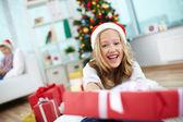 Happy girl peeking out of big red giftbox — Stok fotoğraf
