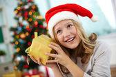 Happy girl holding giftbox — Stock Photo