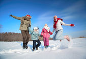 Family in snowdrift — Stock Photo