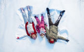 Parents and daughter having fun in snowdrift — Stock Photo