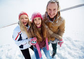 Friends standing in snowdrift in winter — Stock Photo