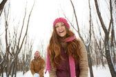 Happy girl in winterwear laughing — Stock Photo