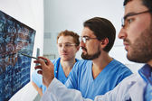 Young male doctors looking at x-ray — Stockfoto