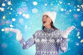 Girl in winterwear enjoying snowfall — Stock Photo