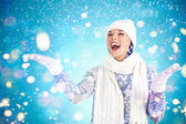 Girl in winterwear enjoying snowfall — Stock Photo