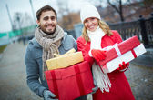 Couple with giftboxes — Stock Photo