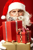 Santa Claus with giftboxes — Stock Photo
