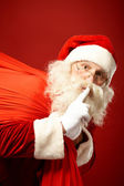 Santa Claus with huge red sack — Foto de Stock